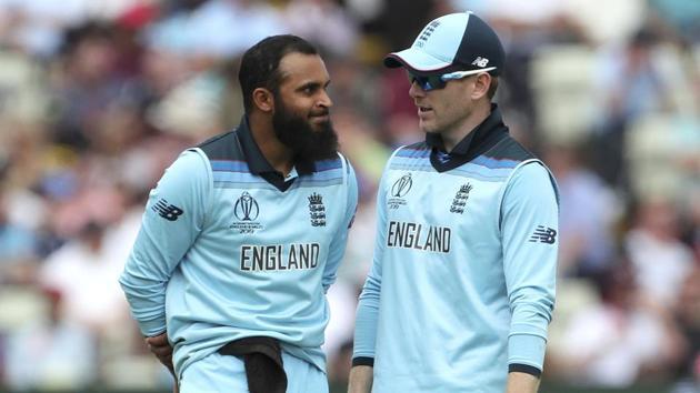 Adil Rashid listens to captain Eoin Morgan during the Cricket World Cup semi-final match between England and Australia at Edgbaston.(AP)