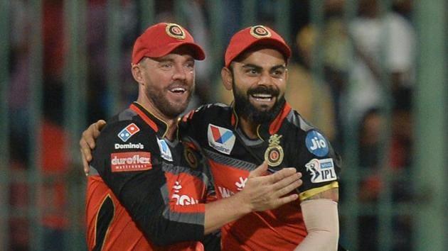 Royal Challengers Bangalore captain Virat Kohli and team mate AB de Villiers celebrate a wicket in the Indian Premier League.(AFP)