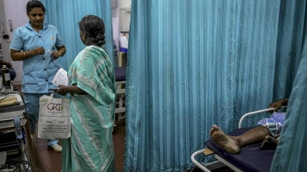 """A nurse and a visitor in the emergency ward at a Sudar Hospitals clinic. Elsewhere, hospitals face similar challenges. Ashok Thorat, chief medical officer at a state-run hospital in Beed, Maharashtra said, """"More people turn up at our government hospital because private clinics have to pay more to buy water and pass on costs to patients. We can arrange at least some free water from the municipal corporation, but even that has limits."""" (Dhiraj Singh / Bloomberg)"""
