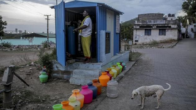 Empty water pots, left to be refilled by a water truck, line a street next to a generator kiosk in a residential area in Chennai. The price of a 12,000-litre water truck soared from 1,200 rupees in April to as high as 6,000 rupees since shortages began, The News Minute website reported. (Dhiraj Singh / Bloomberg)