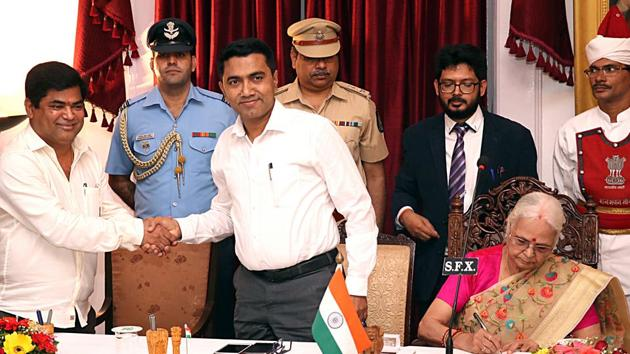 Goa Chief Minister Pramod Sawant greets former Opposition leader Chandrakant Kavlekar, who joined the BJP along with nine other Congress MLAs during the swearing-in ceremony held at Raj Bhavan on Saturday.(ANI PHOTO.)