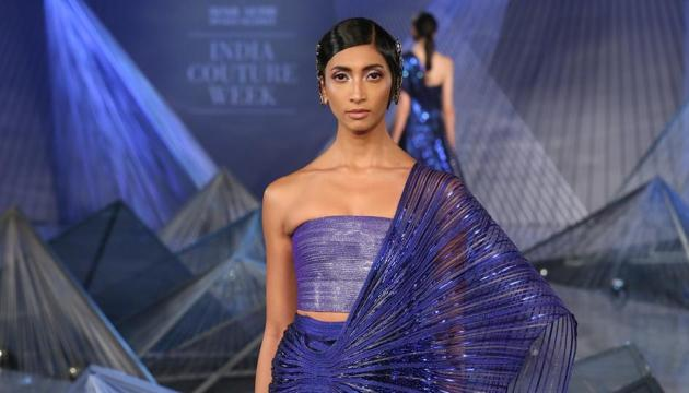 Designer Amit Aggarwal's creation from his preview collection showcased at Hindustan Times and Sunil Sethi Design Alliance India Couture Week 2018.(Amal KS/Hindustan Times)