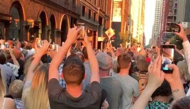 People evacuated from a Carnegie Hall concert during a blackout due to widespread power outages in the Manhattan borough of New York City, U.S, listen to the choir singing on the street in this still frame obtained via social media video July 13, 2019. BRIALLEN HOPPER via REUTERS(BRIALLEN HOPPER)