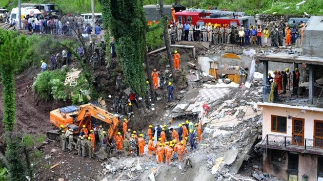 Rescue workers from NDRF removing debris after a building collapsed at Kumarhatti-Nahan road in Solan on Sunday.(Anil Dayal /HT Photo)