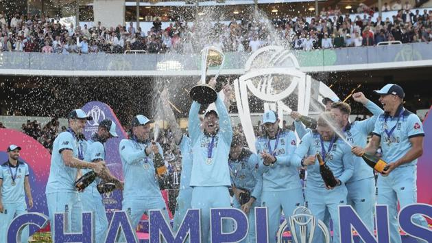 England's captain Eoin Morgan is sprayed with champagne as he raises the trophy after winning the Cricket World Cup.(AP)