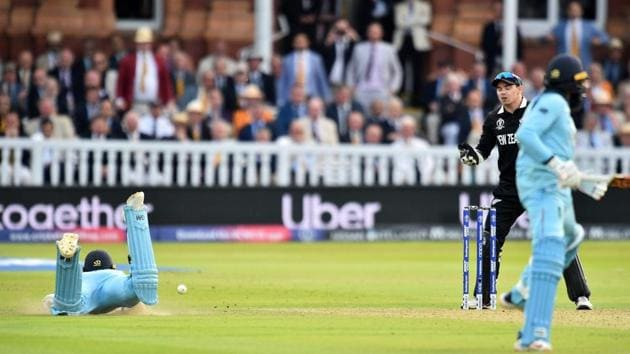 The ball hits England's Ben Stokes (L), deflecting to reach the boundary as he dives to make his ground(AFP)
