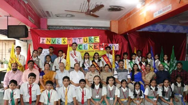 The newly-elected student council members of Chembur English High School were conferred with badges and sashes.(HT Photo)