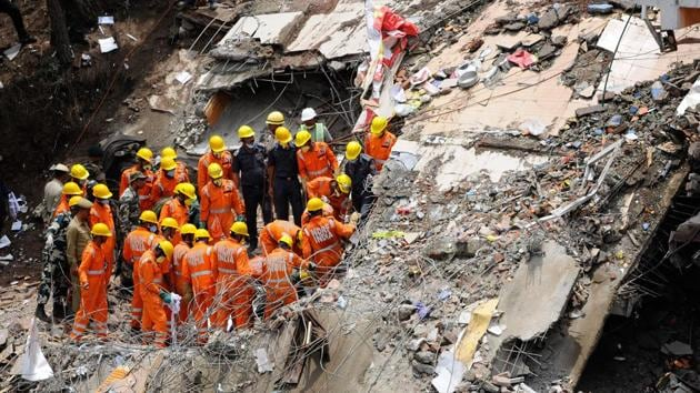 NDRF Personnel carried out a rescue operation after a building collapsed at Kumarhatti in Solan, Himachal Pradesh, on Monday, July 15, 2019.(ANI)