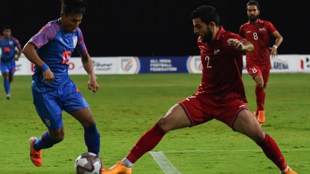 India's forward Udanta Singh (L) and Syria's defender Abdullah Al Shami (R) fight for the ball.(AFP)