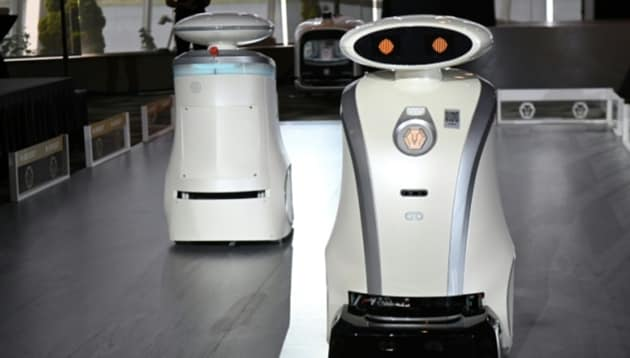 Four of the robots, which have oval-shaped heads with lights for eyes, have already got down to work and it is hoped that 300 will be put into service by March next year.(AFP)