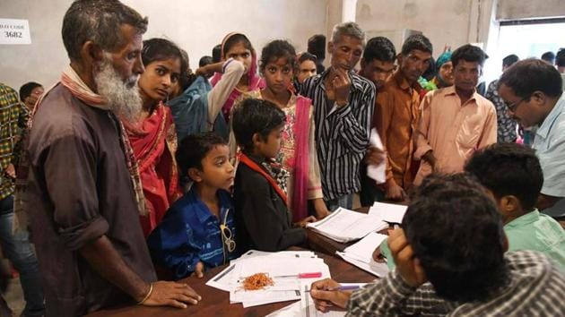 The Solicitor General of India told the Supreme Court that re-verification of NRC is needed as genuine citizens have been left out. Assam State National Register of Citizens (NRC) officials check documents of Indian residents during AN appeal hearing against the non-inclusion of their names in the citizens register at a NRC office in Dhubri, some 261 kms from Guwahati.(AFP)