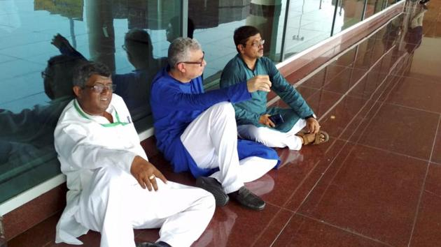 Varanasi: Derek O'Brien led TMC delegation sit on a dharna, after they were stopped by police at the airport, while on their way to meet family members of victims killed in clashes over a land dispute in Sonbhadra on July 17, at Varanasi airport, Saturday, July 20, 2019.(PTI)