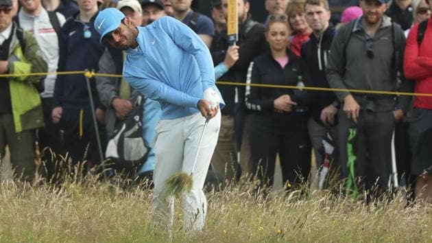 India's Shubhankar Sharma plays out of the rough on the 1st hole.(AP)