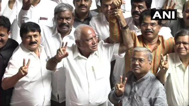 BJP's Karnataka chief BS Yeddyurappa along with the BJP MLAs flashed victory sign in the Assembly, after HD Kumaraswamy led government was ousted in the trust vote(ANI Photo)