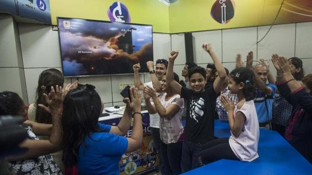 People watch and celebrate the successful launch of Chandrayaan 2 at Nehru Science Centre in Mumbai(Pratik Chorge/HT Photo)