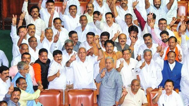 Former Chief Minister of Karnataka and BJP leader BS Yeddyurappa shows victory sign along with other members after the defeat of Congress-JD(S) coalition government at Vidhana Soudha in Bengaluru on Tuesday. (ANI Photo)