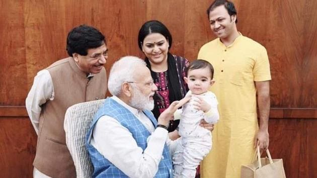 On Tuesday, Rajya Sabha MP Satyanarayan Jatia, his son, daughter-in-law and six-month-old Rudrakshi went to meet the PM in Parliament.(Twitter/ANI)