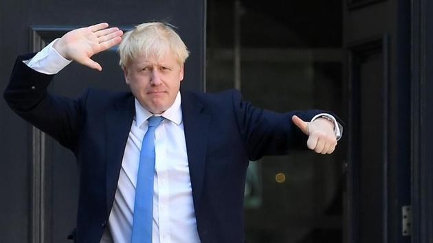 Boris Johnson gestures as he arrives at the Conservative Party headquarters, after being announced as Britain's next Prime Minister, in London.(REUTERS Photo)