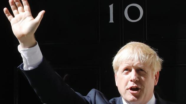 Britain's new Prime Minister Boris Johnson waves after giving a speech outside 10 Downing Street in London on July 24, 2019 on the day he was formally appointed British prime minister.(AFP)