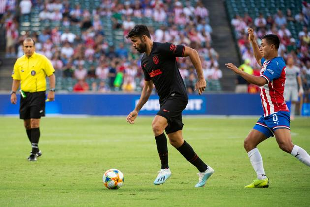 Diego Costa (L) controls the ball during the International Champions Cup football match between Chivas de Guadalajara and Atletico de Madrid at Globe Life Park in Arlington.(AFP)