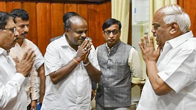 Karnataka Chief Minister HD Kumaraswamy and his deputy G Parameshwara meet Assembly Speaker KR Ramesh Kumar after losing the vote of confidence in Assembly Session at Vidhana Soudha, in Bengaluru, Tuesday, July 23, 2019.(PTI)