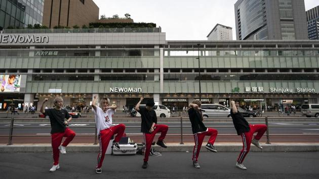 A Japanese dance and vocal group called Banquet performs on the street outside Shinjuku Station. (Jae C. Hong / AP)