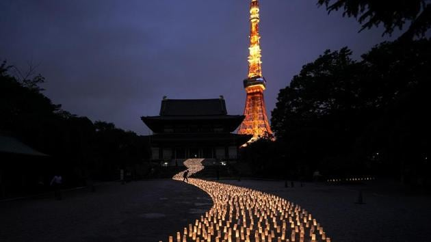 Thousands of candles are arranged in the shape of the Milky Way to celebrate Tanabata, a Japanese star festival, at Zojoji Temple. The Olympics will be simply a sideshow for some Tokyo visitors, astounded by the cleanliness, courtesy and order. Japan's sprawling capital is a dense mix of the traditional and eccentric where bowing meets bustle. (Jae C. Hong / AP)