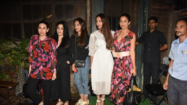 Karishma and Amrita stepped out for a girls night out in matching floral prints.(Varinder Chawla)