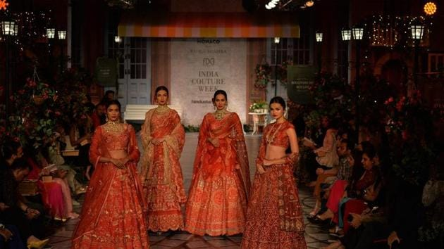 The models look stunning in Rahul Mishra's creations.(AFP)