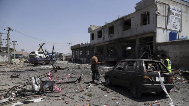 Afghan security personnel inspect at the site of a suicide attack in Kabul, Afghanistan.(AP Photo)