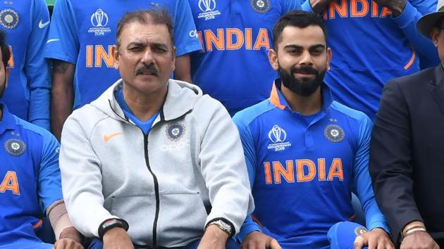 India's head coach Ravi Shastri (L) and India's captain Virat Kohli (R) pose for a group photograph with India team and management ahead of the 2019 Cricket World Cup group stage match between Sri Lanka and India at Headingley in Leeds, northern England, on July 6, 2019.(AFP)