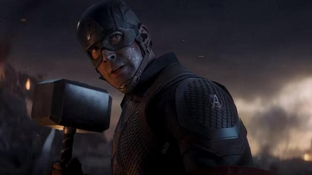 Captain America lifts Thor's hammer in a scene from Avengers: Endgame.
