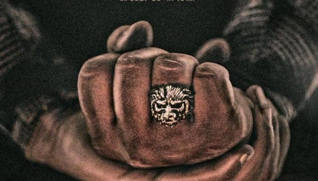 KGF Chapter 2 poster shows a dramatic ring with the face of a lion.