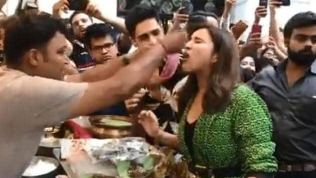 Parineeti Chopra and Sidharth Malhotra eating fire paan in New Delhi.