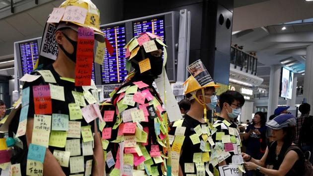 """Demonstrators wear post-it notes as part of the """"Lennon Wall"""" movement during a protest against the recent violence in Yuen Long, at Hong Kong airport, China July 26, 2019.(REUTERS)"""