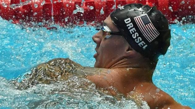 USA's Caeleb Dressel celebrates winning the final of the men's 100m freestyle event.(AFP)