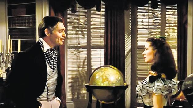 Rhett Butler and Scarlett O'Hara (played by Clark Gable and Vivien Leigh in the film Gone With The Wind) at the library in Twelve Oaks.