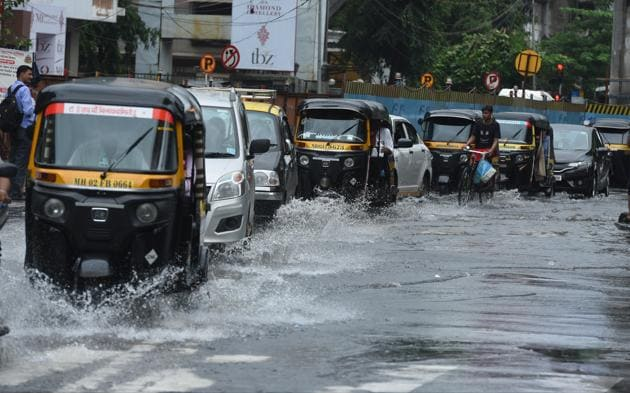 The downpour also led to waterlogging, flight and railway disruptions, and traffic jams across the city.(HT PHOTO)