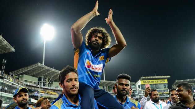 Lasith Malinga, who played the last One Day International (ODI) cricket match of his career, celebrates with teammates.(AFP)