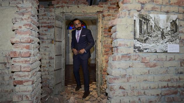 Indian film actor Rahul Bose looks at an installation representing a riot-hit house during the time of the India-Pakistan partition at the Partition Museum in Amritsar, Punjab. (Narinder Nanu / AFP)