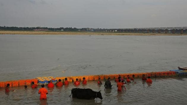 Hindu pilgrims, known as Kanwarias, take holy dips in the Ganges River in Prayagraj, Uttar Pradesh. Kanwarias are devotees performing a ritual pilgrimage in which they walk the roads of India, clad in saffron, and carrying ornately decorated canisters of sacred water from the Ganges River over their shoulders to take it back to Hindu temples in their hometowns, during the Hindu lunar month of Shravana. (Rajesh Kumar Singh / AP)