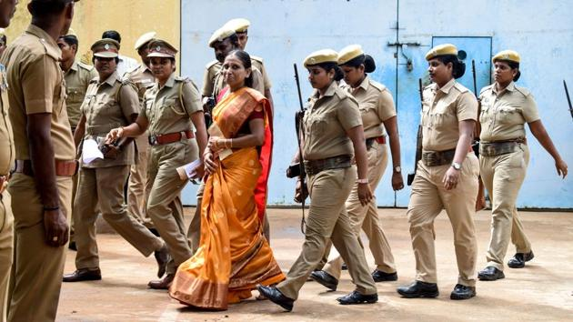 Nalini Sriharan (C), who was convicted in the assassination case of former Prime Minister Rajiv Gandhi, is released from the Vellore Central Prison on a one-month parole to attend her daughter's wedding, in Vellore. (STR / AFP)