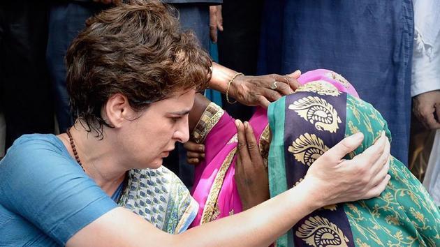 Congress general secretary Priyanka Gandhi Vadra consoles a family member of aSonbhadra massacre victim.(PTI PHOTO.)