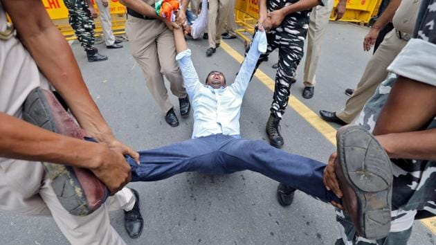 Police detain a member of the Delhi Pradesh Youth Congress during a protest against an amendment to the Right to Information Act, in New Delhi. (Anushree Fadnavis / REUTERS)