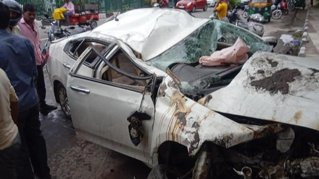 At least two persons were killed and two others critically injured after their car crashed into a road divider on Delhi's Ring Road early Sunday morning.(HT Photo)