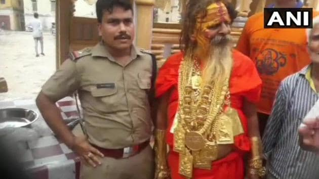 This baba wearing kilos of gold ornaments has become a centre of attraction.(Twitter/@ANI)