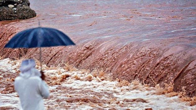 The flooded Tawi river as heavy rain lashes Jammu on Sunday.(PTI Photo)