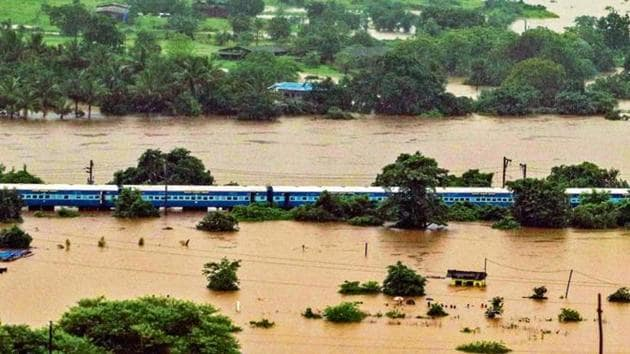 Mahalaxmi Express was first delayed when it reached Ambernath station, where the tracks were flooded, at 10pm on Friday.(HT Photo)