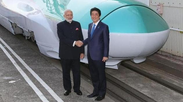 PM Narendra Modi with his Japanese counterpart Shinzo Abe during inspection of a bullet train manufacturing plant in Kobe, Hyogo prefecture on Novermber 12, 2016.(AFP Photo)