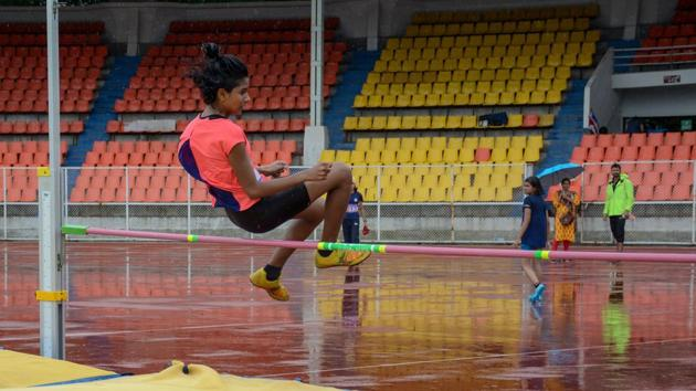 Nalini Pillay in action during the girls under-16 high jump at Pune District Junior Athletics Championship at Shiv Chhatrapati Sports Complex Balewadi in Pune, India, on Saturday.(Milind Saurkar/HT Photo)